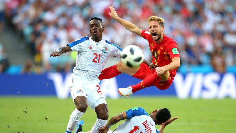 Jose Luis Rodriguez and Eric Davis (not pictured) clash with Dries Mertens during the group G match between Belgium and Panama