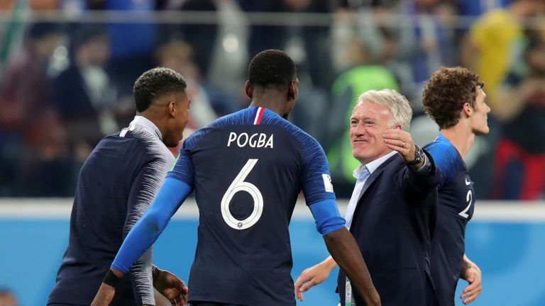 Didier Deschamps congratulates his players after they reach the World Cup final