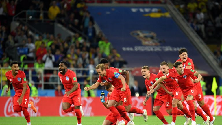 England players celebrate after Eric Dier's spot kick seals a 4-3 penalty shootout victory over Colombia