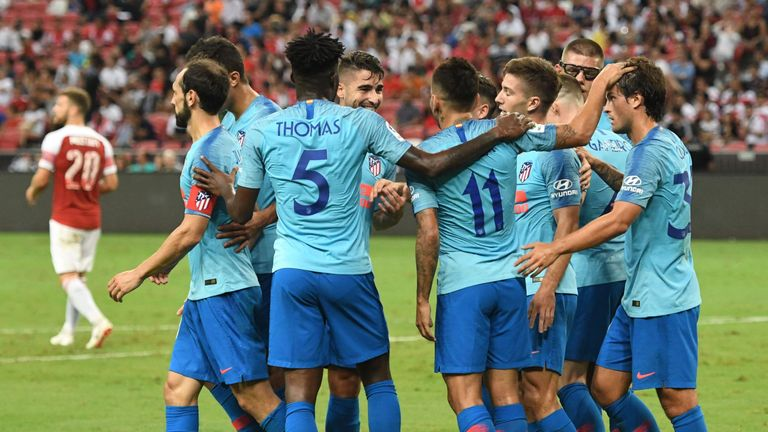 Atletico Madrid players celebrate Luciano Vietto's opener in Singapore