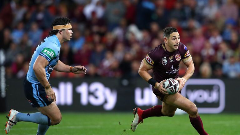 Billy Slater of Queensland runs with the ball