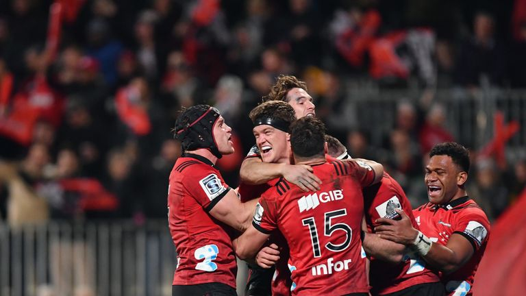 Scott Barrett is congratulated by team mates after scoring against the Highlanders