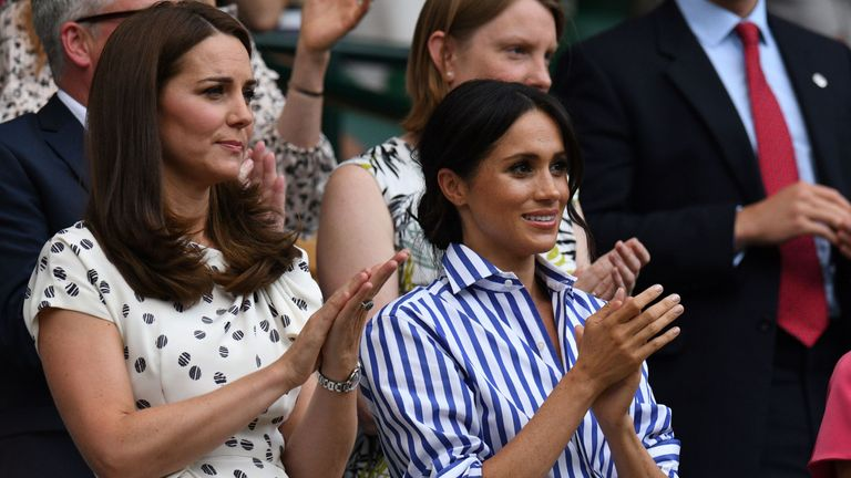 Kate Middleton, Duchess of Cambridge, (left) and Meghan Markle, Duchess of Sussex, applaud the players out onto Centre Court