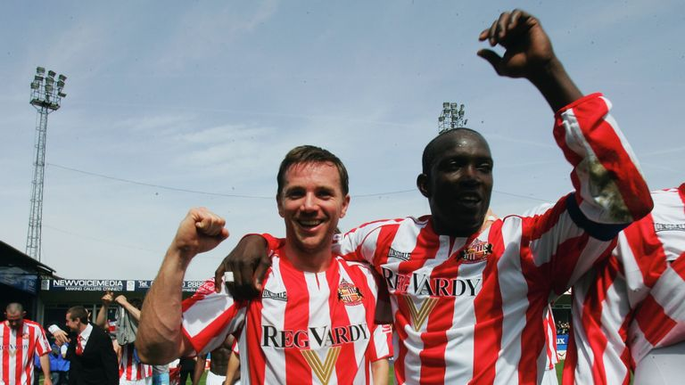 Yorke (right) celebrates winning the Championship title at Kenilworth Road in May 2007