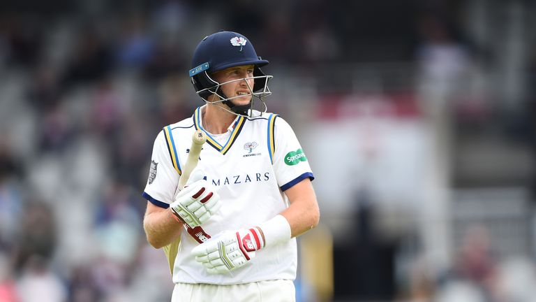 Joe Root trudges off after being trapped lbw by Clark at Old Trafford