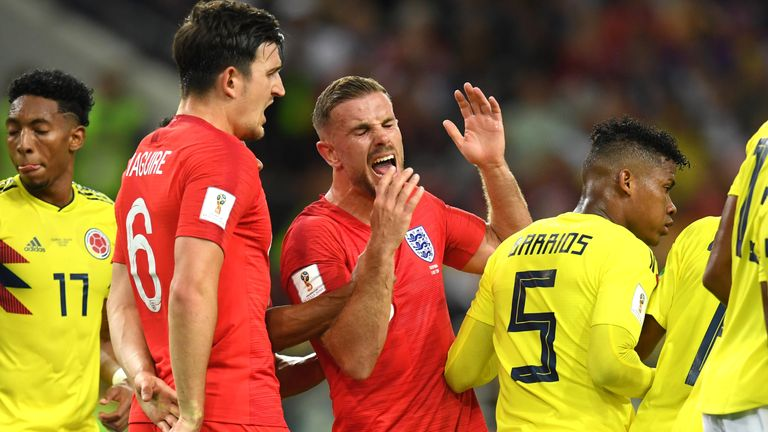 Jordan Henderson reacts after a headbutt on the chest from Wilmar Barrios