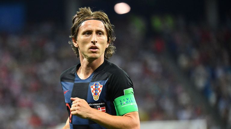 Golden Ball winner Luka Modric starts in midfield
