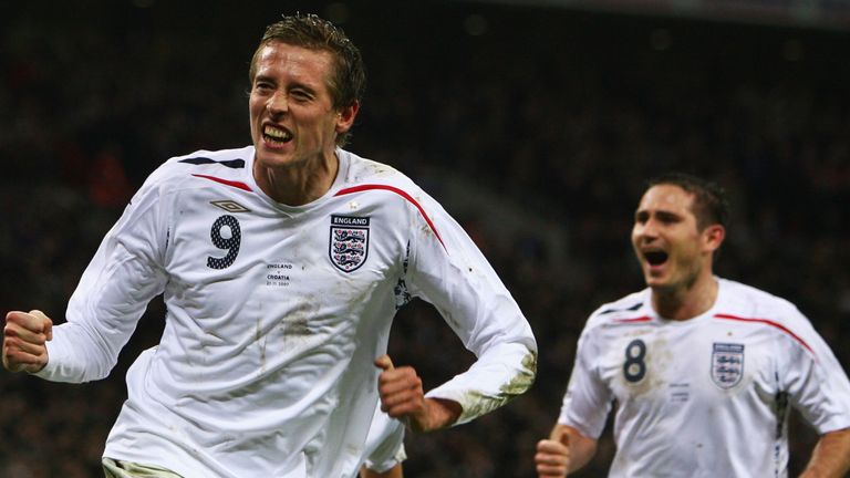 Peter Crouch celebrates after pulling England level