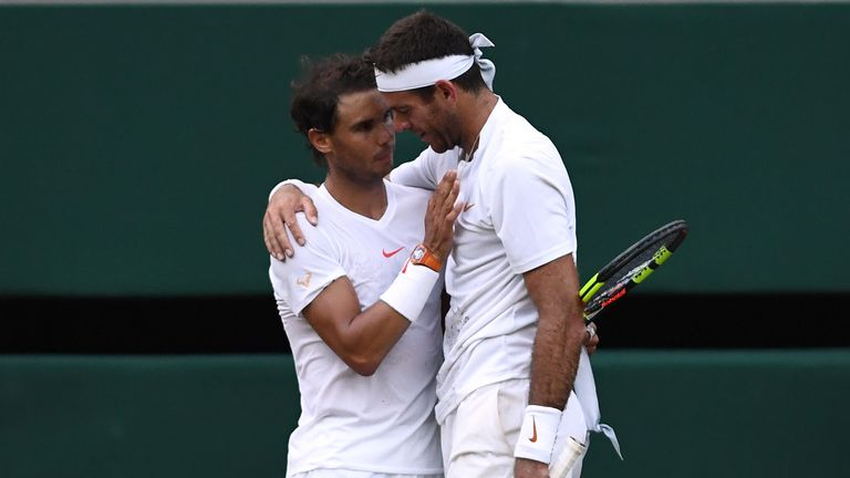 Juan Martin del Potro (right) and Rafael Nadal embrace following their epic quarter-final