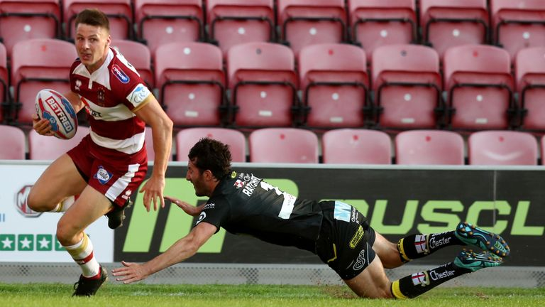 Wigan's Tom Davies crosses for the first try at the DW Stadium