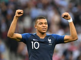 Kylian Mbappe celebrates after France take a 4-1 lead