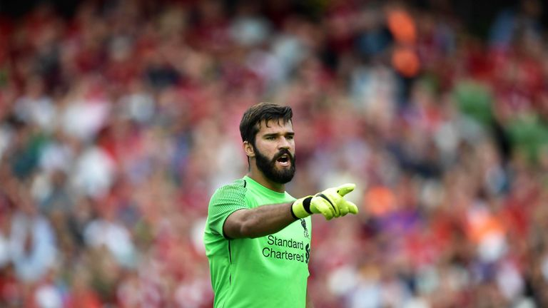 Alisson Becker in action for Liverpool against Napoli