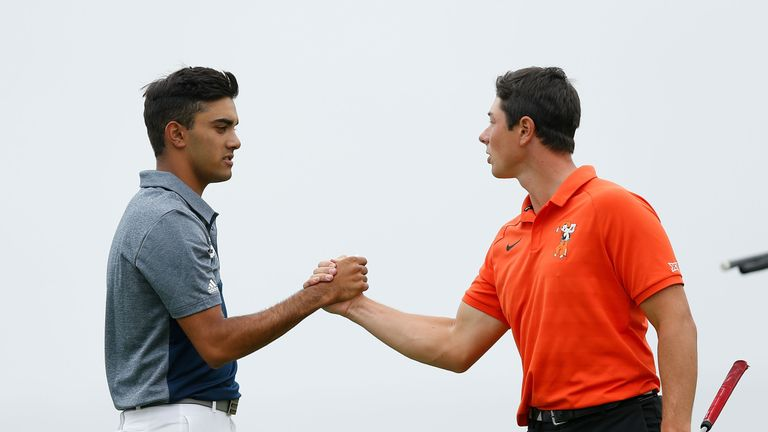 Devon Bling (left) shakes hands with Viktor Hovland after the first round of the final