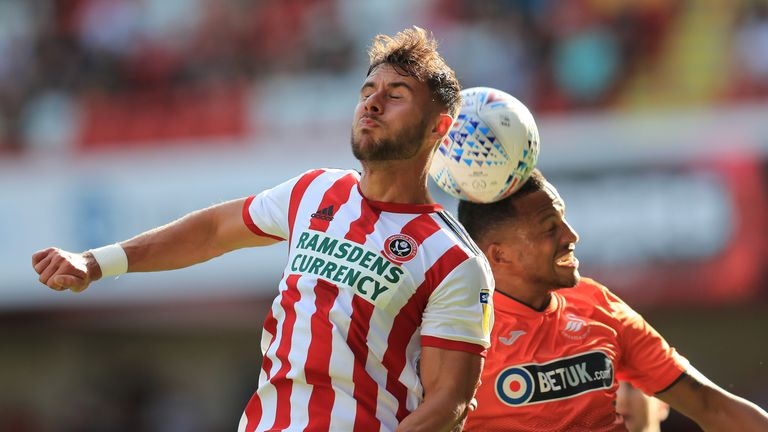 Sheffield United's George Baldock and Swansea City's Martin Olsson in action at Bramall Lane