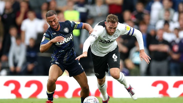 Roofe and Derby County's Richard Keogh battle for the ball at Pride Park
