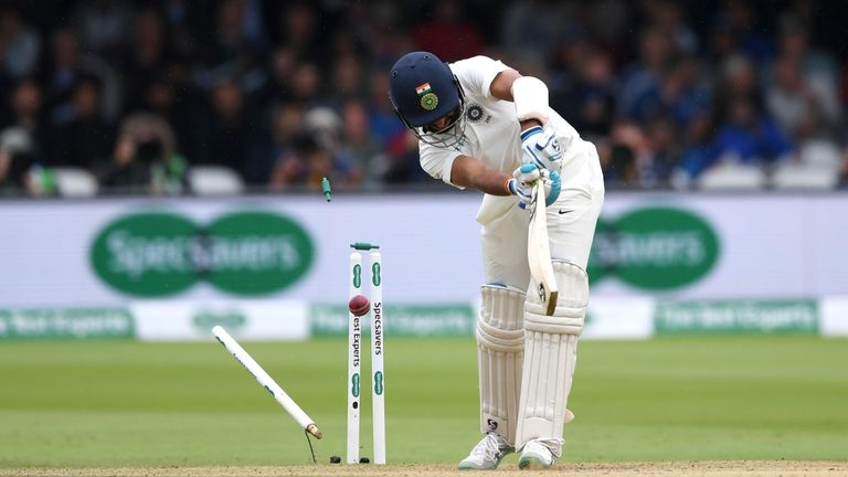 Cheteshwar Pujara's resistance was ended when he was bowled by Stuart Broad for 17 off 87 balls