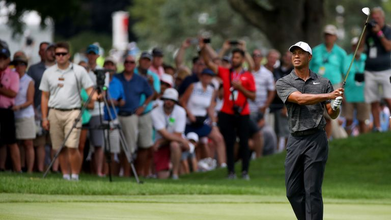 Tiger Woods is five behind at the halfway stage