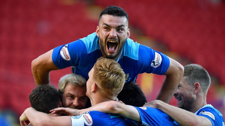 Tony Watt celebrates with his new St Johnstone team mates during a League Cup group stage match