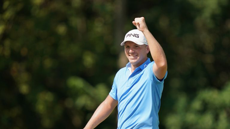 Matt Wallace celebrates his ace at the 16th