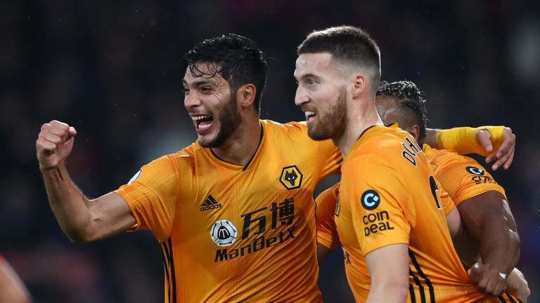 Raul Jimenez celebrates with team-mates Matt Doherty and Adama Traore