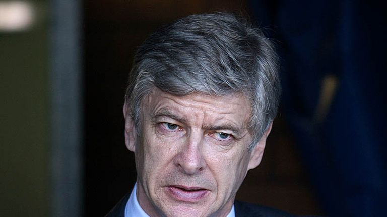 Arsene Wenger arrives at the JJB Stadium for Arsenals clash with Wigan.