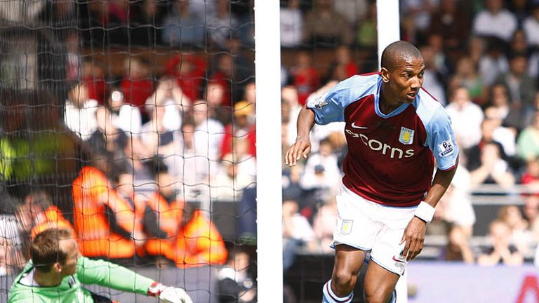 Young celebrates his equaliser for Aston Villa.