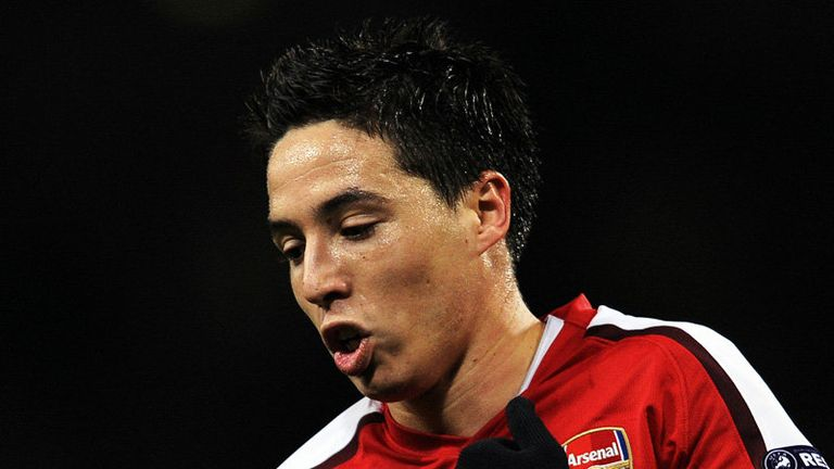 Samir Nasri wheels away after doubling the lead for Arsenal