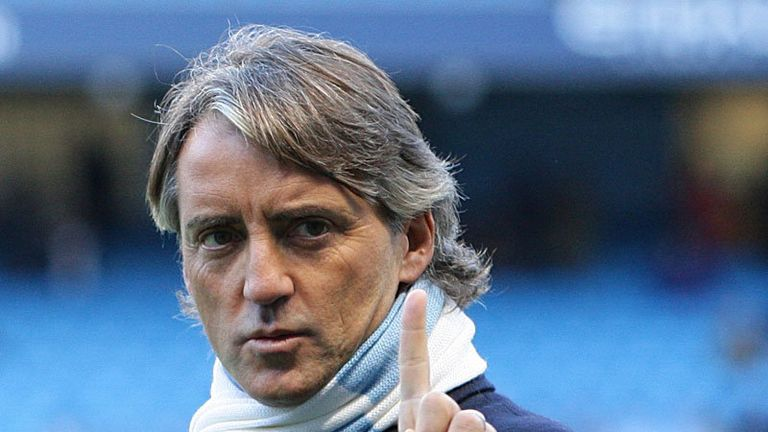 Roberto Mancini takes charge of his first game for Manchester City