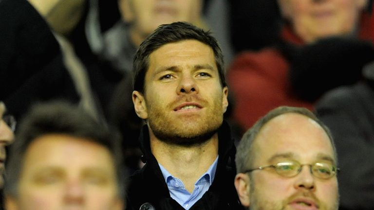 Former Liverpool midfielder Xabi Alonso attends the big clash.