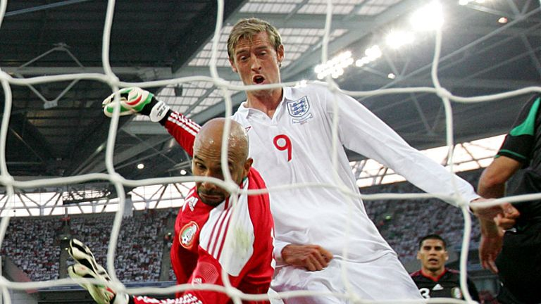 The ball appears to roll down the body of Peter Crouch before finding the net