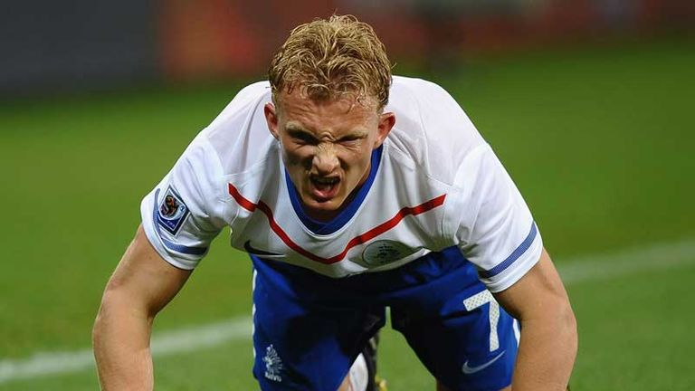 Dirk Kuyt is on all fours and looks in pain.