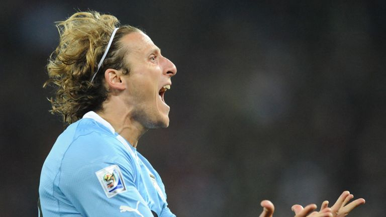 Diego Forlan roars with delight.