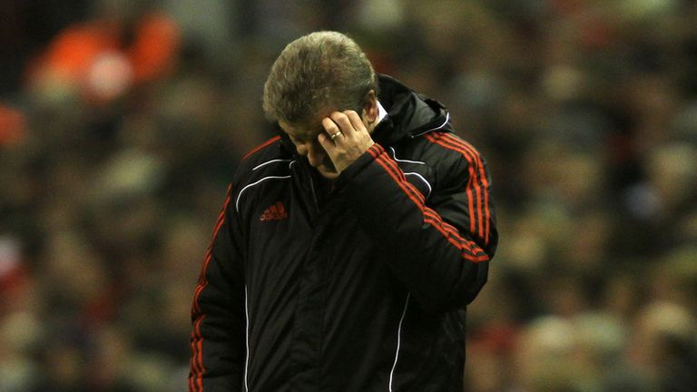 Liverpool manager looking dejected during their defeat to Wolves at Anfield