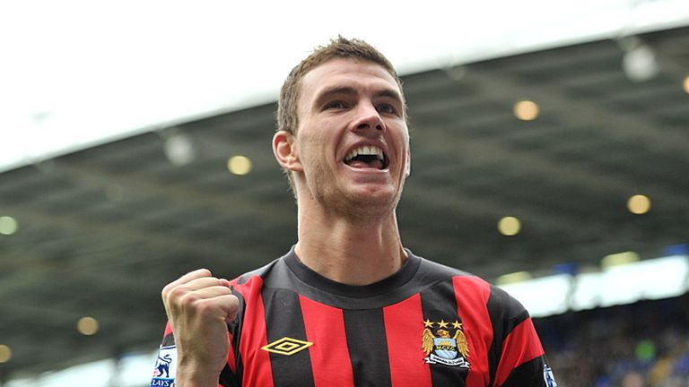 Edin Dzeko celebrates his goal for Man City