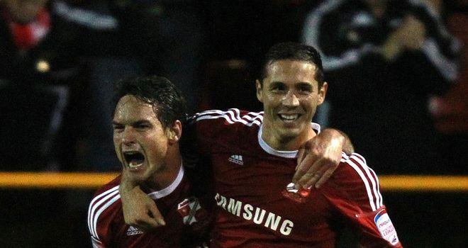 Risser (left): Celebrates his goal with Devera