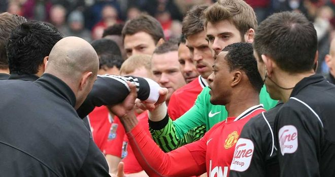 Patrice Evra grabbed the arm of Luis Suarez after the Liverpool striker refused to shake hands