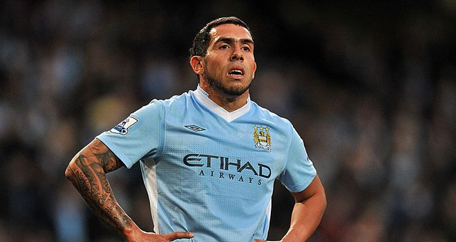 Carlos Tevez: Has been linked with AC Milan, but says he is happy at Manchester City