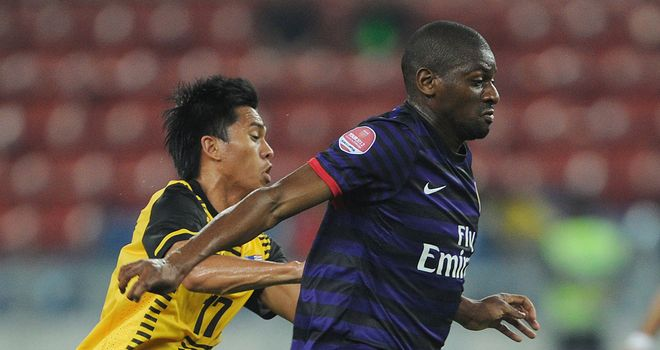 Abou Diaby and Arsenal found the going tough in Kuala Lumpur