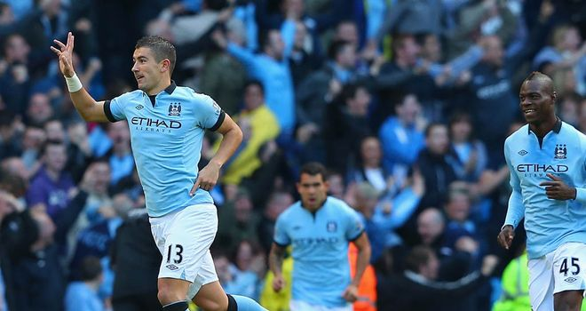 Aleksandar Kolarov celebrates his free-kick opener for Man City