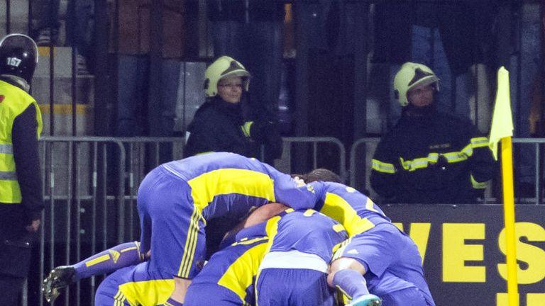 Maribors players celebrate Robert Berics opener against Spurs