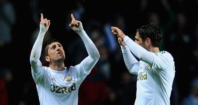 Pablo Hernandez (left): Struck late to earn Swansea a merited point against Chelsea