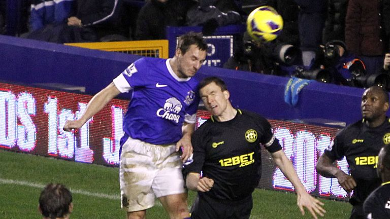 Phil Jagielka: Rises above Gary Caldwell to net what proved to be the winner