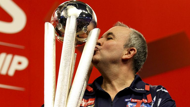Phil Taylor celebrates after winning his 16th World Championship in 2013
