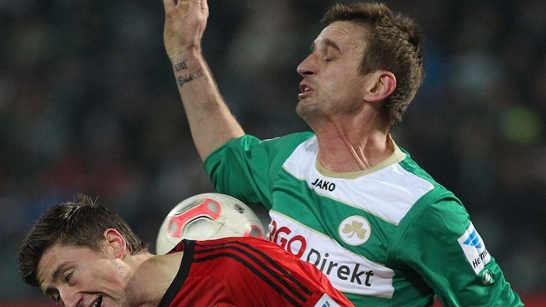 Jens Hegeler competes with Milorad Pekovic