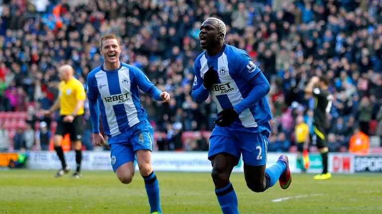 Arouna Kone scores the winning goal in Wigan's match with Norwich.