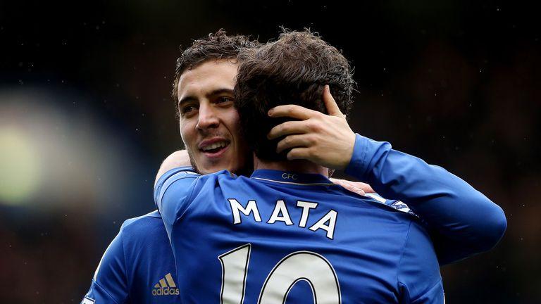 Eden Hazard of Chelsea celebrates with Juan Mata