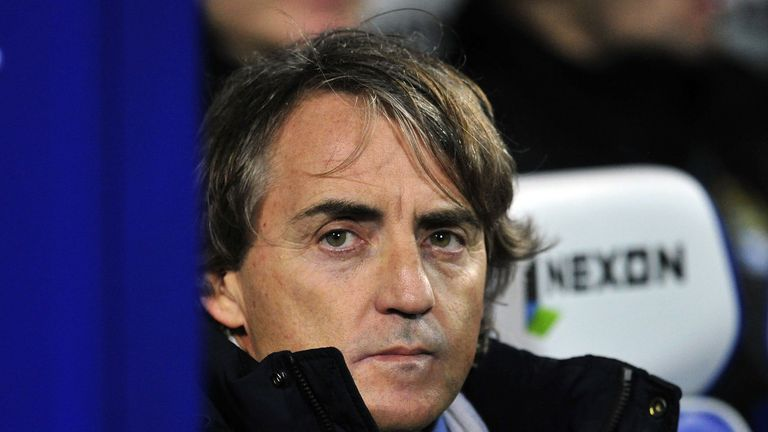 Roberto Mancini looks on before the Premier League match at Queens Park Rangers