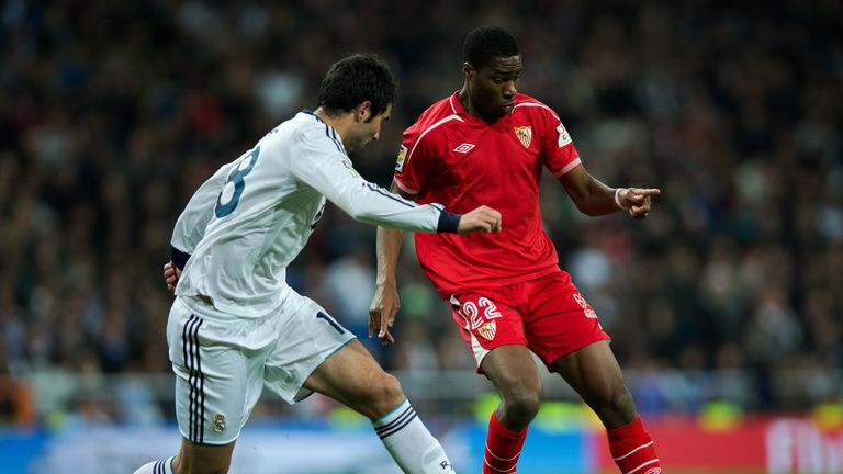 Geoffrey Kondogbia of Sevilla duels for the ball with Raul Albiol of Real Madrid during the La Liga match at the Santiago Bernabeu.