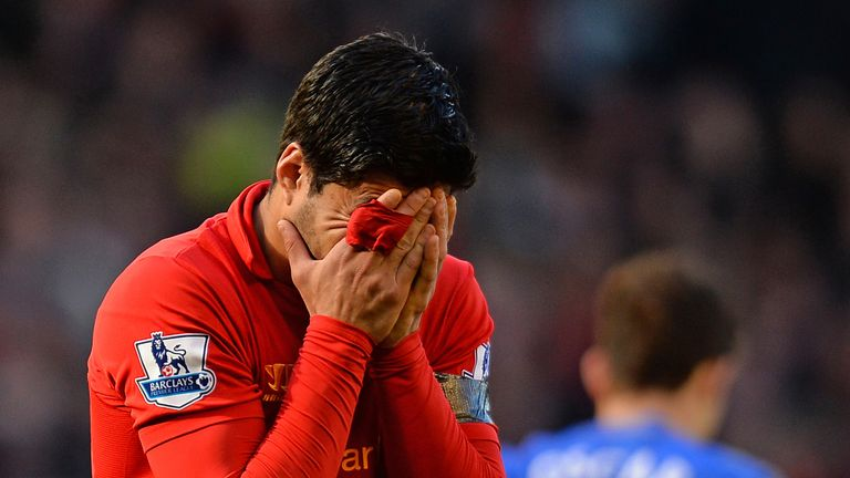 Luis Suarez reacts during the Premier League match between Liverpool and Chelsea.