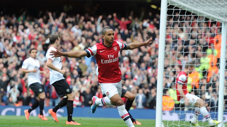 Arsenal winger Theo Walcott celebrates after scoring in the Premier League game against Manchester United at Emirates Stadium.